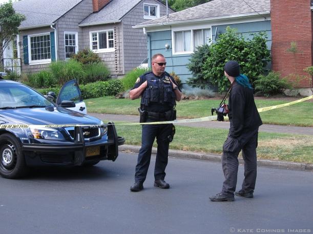 Mike BlueHair talking to policeman